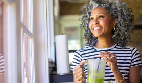 Woman enjoying a drink with her fiber supplement